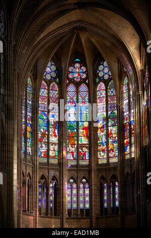 Gothic stained glass windows depicting scenes from the Martyrdom of Saint Denis, Cathedral Basilica of Saint Denis - Stock Photo