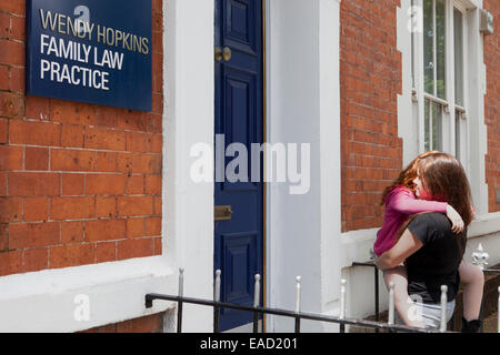 Young mother and her daughter attending a family law practice - Stock Photo
