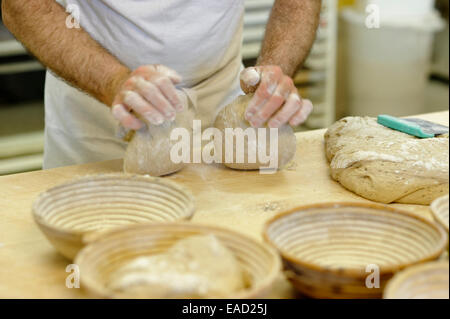 Bread making, baker, hands kneading a bread dough, sourdough - Stock Photo