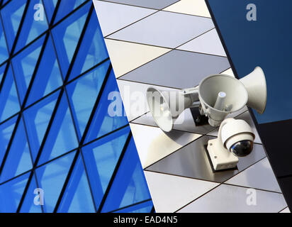 Modern security equipment placed on modern architecture building - Stock Photo
