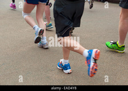 Legs of runners in the Yorkshire Marathon York North Yorkshire England UK United Kingdom GB Great Britain - Stock Photo