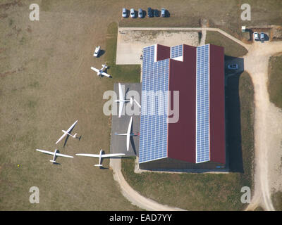 Aerial view of gliders hangar with photovoltaic panels on roof, Pont Saint Vincent aerodrome, Meurthe et Moselle, - Stock Photo