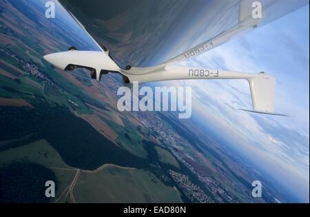 Glider plane in aerobatic flight over Nancy, Lorraine region, France - Stock Photo