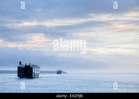 Hoegh Autoliners car transport ship heads up the Solent to Southampton at dawn - Stock Photo