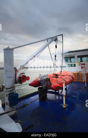 inflatable tender with Single Arm Slewing Boat/Raft Launching Applicance & Crane on ferry - Stock Photo
