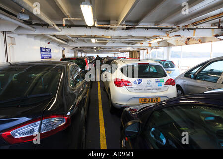 Restricted height car deck on ferry - Stock Photo