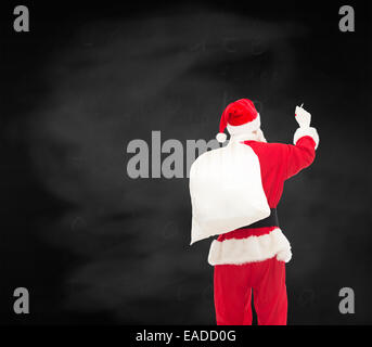 man in costume of santa claus with bag - Stock Photo