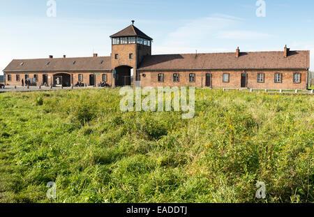 AUSCHWITZ, POLAND - OCTOBER 25, 2014: The Main entrance of the infamous Auschwitz II-Birkenau, a former Nazi extermination - Stock Photo