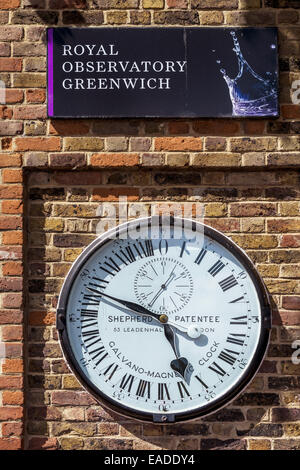 The Shepherd Gate Clock is the clock mounted on the wall outside the gate of the Royal Greenwich Observatory building - Stock Photo