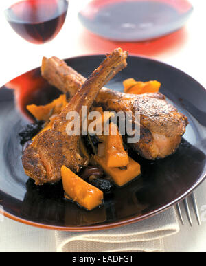 Plated Lamb Chops and Red Wine - Stock Photo