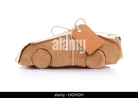 Car wrapped in brown paper - Stock Photo
