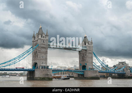 Tower Bridge in London on an overcast cloudy day - Stock Photo