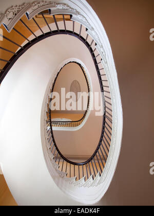 Spiraling staircase of old House. - Stock Photo