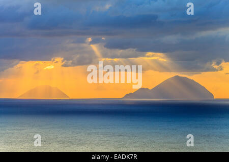 View of Aeolian islands of Filicudi and Alicudi  at sunset - Stock Photo