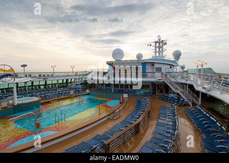 Swimming pool on the deck of Royal Caribbean's Brilliance of the Seas cruise ship. - Stock Photo
