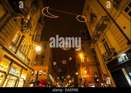 Turin, Italy. 12th Nov, 2014. Italy Piedmont Turin ' Luci d'Artista' in Via Garibaldi - Palomar - By Giulio Paolini - Stock Photo