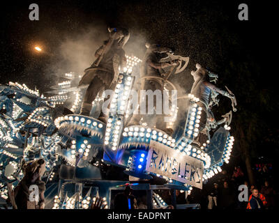 Shepton Mallet, UK. 12th November, 2014. Illuminated floats or 'carts' lit up the streets during the Shepton Mallet - Stock Photo