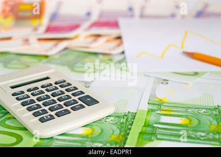 calculator on euro bills with pencil and diagram - Stock Photo