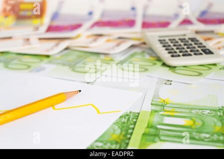 pencil and diagram on euro bills - Stock Photo