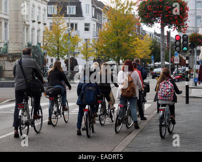Cyclists waiting for green light at a stoplight in Maastricht, The Netherlands, Europe - Stock Photo