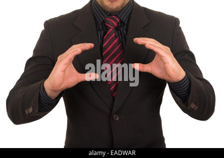 young businessman holding empty space - Stock Photo