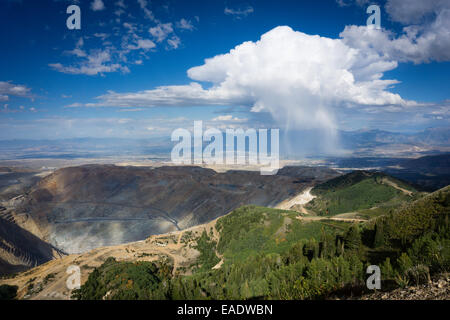 The Bingham Canyon Copper mine outside of Salt Lake City, Utah, with a squall in the distance. - Stock Photo