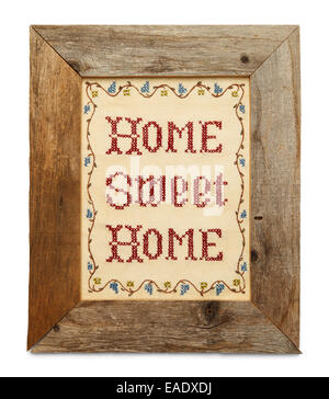 Home Sweet Home Cross Stitch in Rustic Wood Frame Isolated on White Background. - Stock Photo