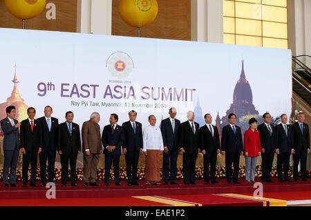 Nay Pyi Taw, Myanmar. 13th Nov, 2014. Participants pose for a group photo at the 9th East Asia Summit. Credit:  - Stock Photo