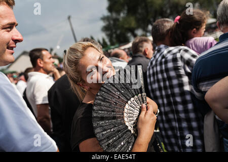 Spectator with a fan watch bulls fight in town of Vitez. Bull fights in Bosnia are known as Korida. - Stock Photo