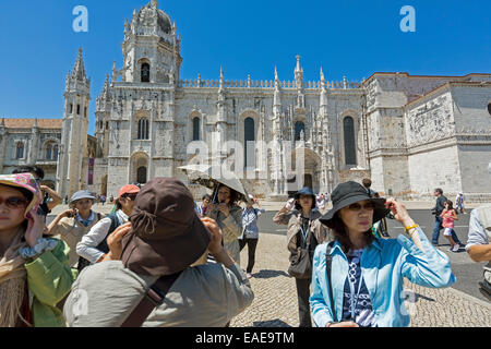 Japanese tourists in front of the Mosteiro dos Jerónimos, Jeronimos Monastery, UNESCO World Cultural Heritage Site, - Stock Photo