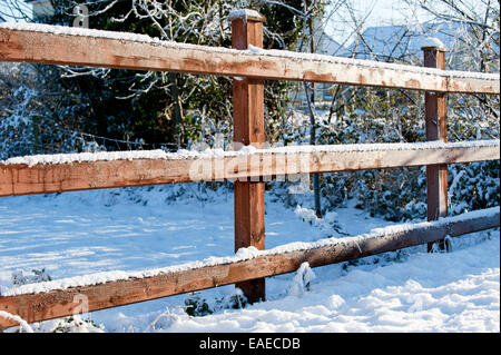 Wooden fences in the winter time - Stock Photo