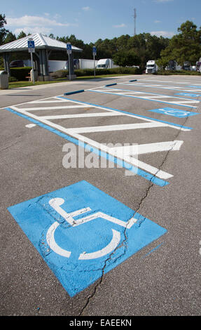 Disabled motorist permit parking spaces in a car park - Stock Photo