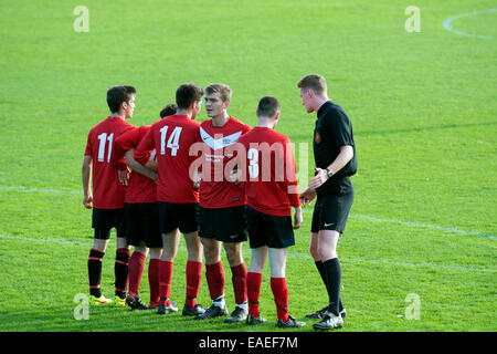University sport UK, men`s football. Players forming a defensive wall. - Stock Photo