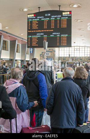Passengers queuing for train in Montreal rail station, Canada - Stock Photo