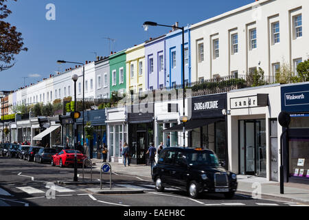 Colourful row of boutique shops on Westbourne Grove, Notting Hill, London, England. - Stock Photo