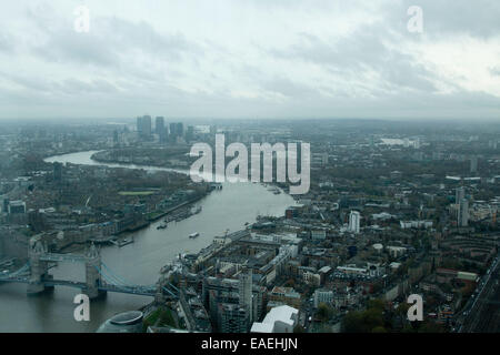 London, UK. 13th November, 2014. A general view of Tower Bridge and Canary Wharf on a  cold overcast autumn  day - Stock Photo
