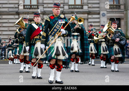 Military Pipe band from the Scottish regiments, parading in George Square, Glasgow, Scotland, UK - Stock Photo