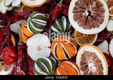 dried limes, apples, oranges, peppers, lemons a pot pouri of festive fruit Jane Ann Butler Photography JABP1099 - Stock Photo