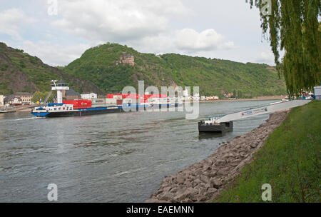 View from St Goar - large barge on River Rhine and Burg Katz castle above St Goarshausen in background - Rhine Valley, - Stock Photo