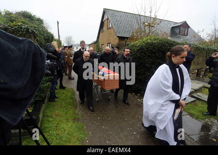 Cardiff, UK. 13th November, 2014.  Pictured: Pallbearers carrying the coffin of Harold Morgan at St Tathan Church, - Stock Photo
