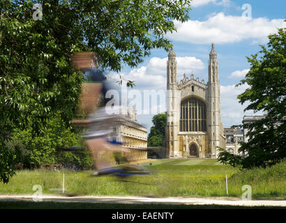 Blurred motion cyclist in the cycle friendly city of Cambridge in front of Kings College Chapel - Stock Photo
