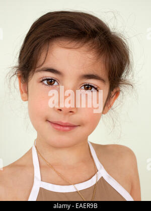 close portrait of a 6 year old girl looking at camera - Stock Photo
