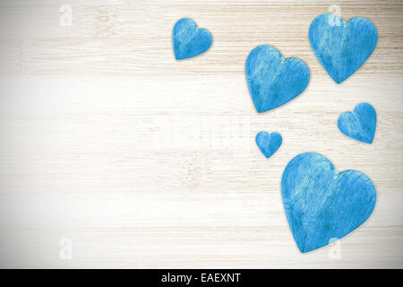 Wooden blue hearts on timbered background, space for text. - Stock Photo