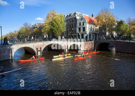 People kayaking in an Amsterdam canal - Keizersgracht and Leliegracht - Stock Photo