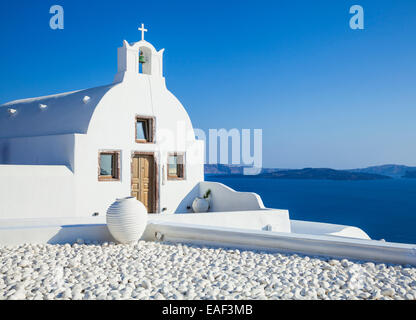 White church of Agios Vasilios overlooking Aegean Sea, Oia, Santorini (Thira), Cyclades Islands, Greek Islands, - Stock Photo