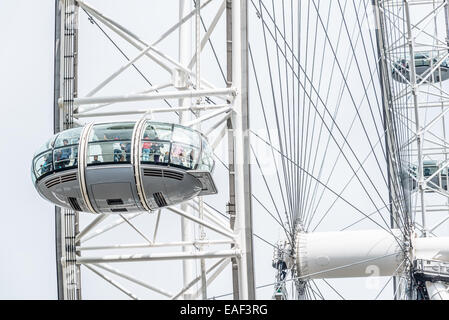 LONDON - AUGUST 27, 2014: Tourists enjoy the view over the city in the capsules of the London Eye, Europe's tallest - Stock Photo