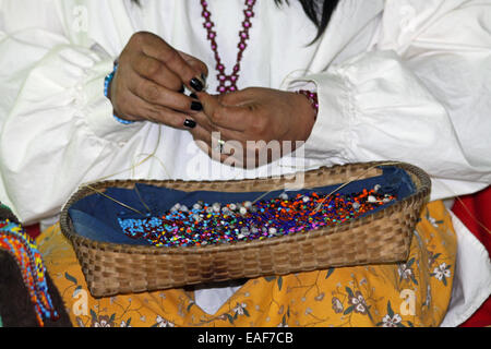 Native American Indian beading by hand - Stock Photo