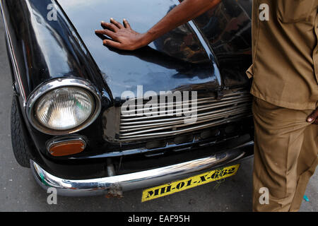 A driver and his old Premier Padmini taxi car in Mumbai, India - Stock Photo