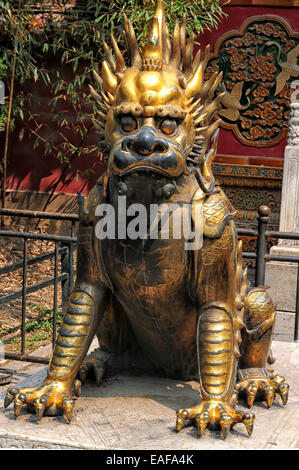 Gilt Imperial Lion Statue in Forbidden City Beijing, China - Stock Photo