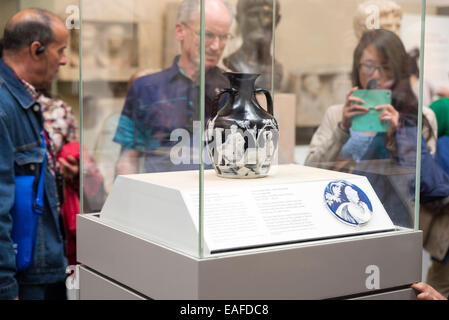 LONDON, UNITED KINGDOM - JUNE 5, 2014: British Museum. Visitors look at the Portland Vase is a Roman cameo glass vase, which is